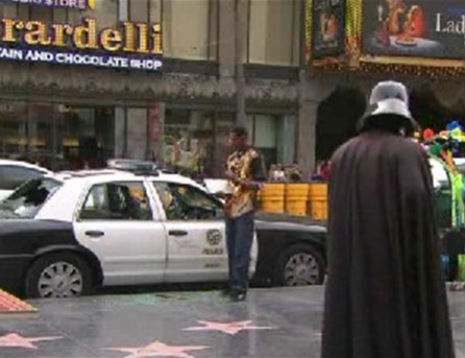 Man shouts 'I love Jesus,' breaks into cop car as Darth Vader looks on and Superman does nothing