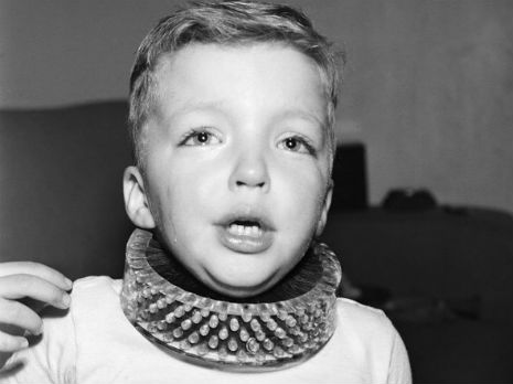 Dirty neck kid wears horrible invention: The Neck Brush, 1950