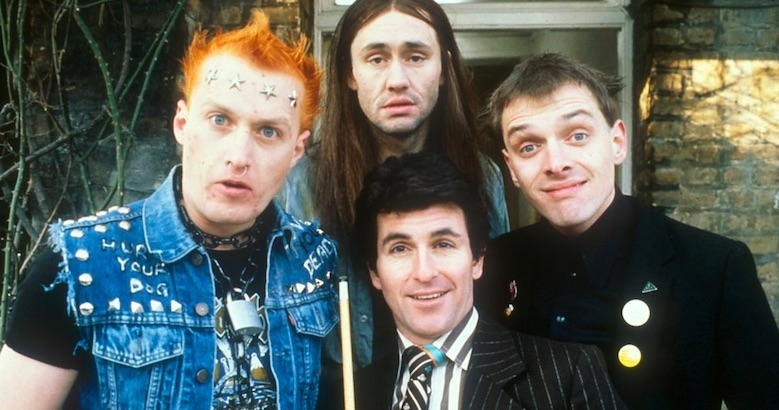 Comedy God Rik Mayall talks 'The Young Ones' with co-writer Ben Elton from 1985
