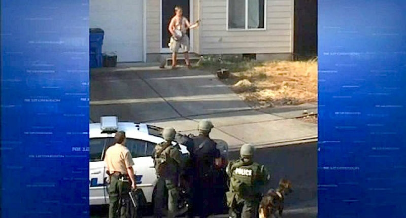 North Side standoff: Police arrest naked man with knife at