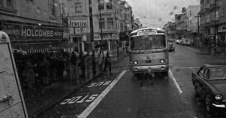 Square people gawk at Haight-Ashbury hippies from the safety of a tour bus, 1967