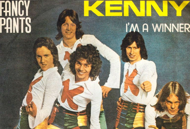 Kenny: Everything about this sucks. The band's name. The song. Their clothes. Everything.