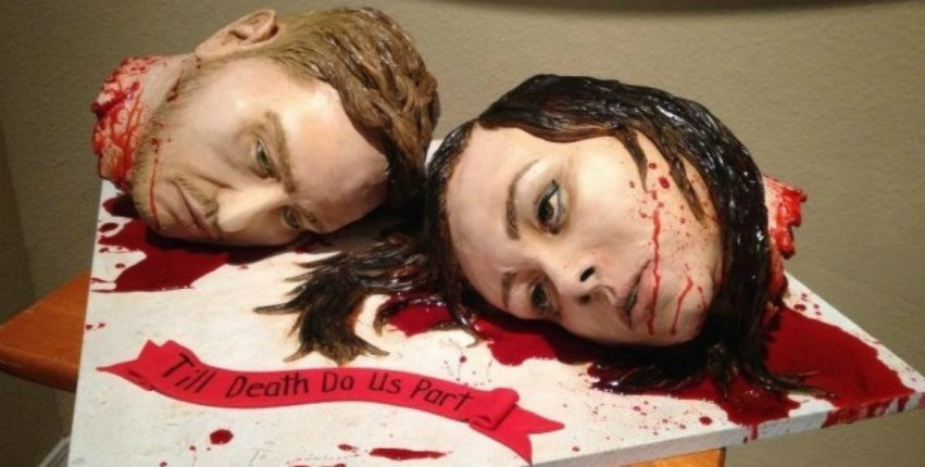 'Till Death Do Us Part': Ghoulish bride & groom serve their 'severed heads' as cake at their wedding