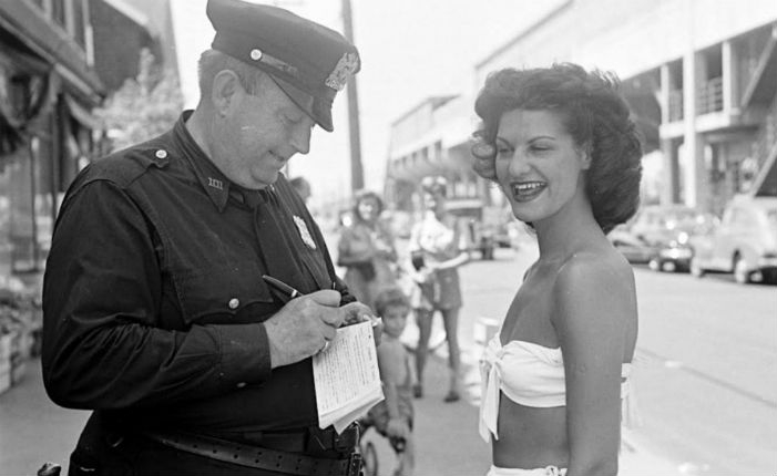 Photographs of people being ticketed for 'indecent exposure' at Rockaway Beach, New York in 1946