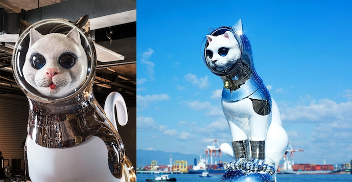 Humongous statues of cats wearing helmets