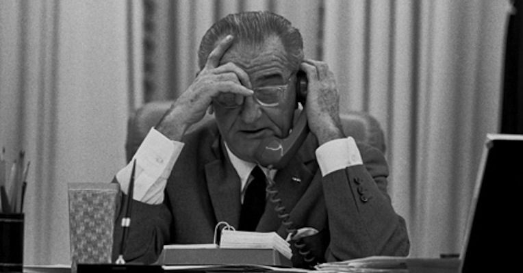 President Lyndon B. Johnson informs his tailor that his new pants must respect his 'bunghole'