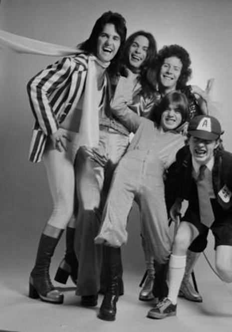An early version of AC/DC with vocalist Dave Evans looking very glam (far left) with Angus and Malcom Young