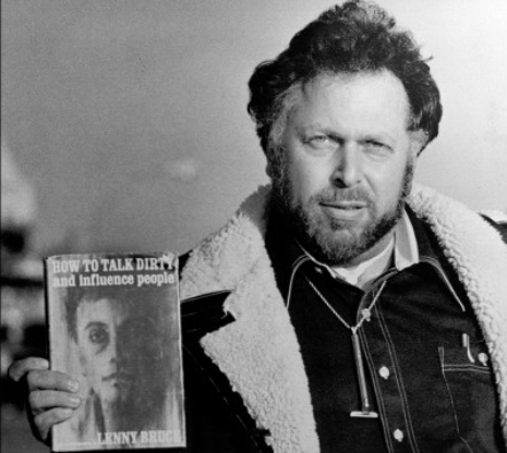 Al Goldstein holding a copy of Lenny Bruce's book,