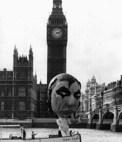 The Alice Cooper balloon taking a ride on the Ferry Prince floating by Big Ben and the House of Parliment in 1975