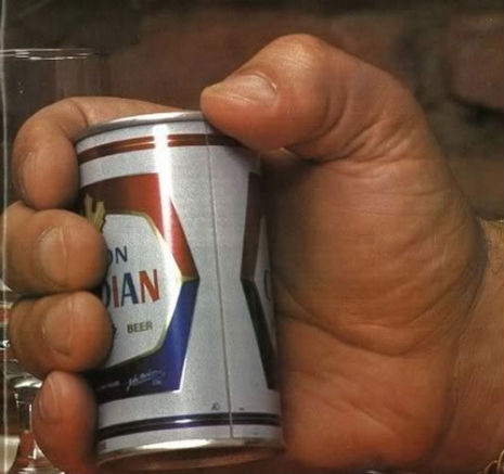 Just a photo of André the Giant's hand holding a can of beer