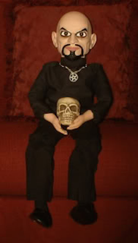 Anton Lavey ventriloquist dummy with pentagram necklace and skull