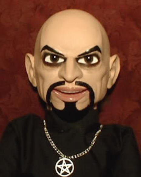 Anton Lavey ventriloquist dummy smiling