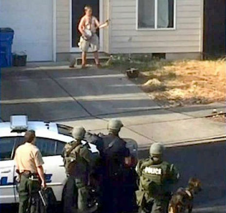 Knife-wielding nude dude playing banjo subdued by police