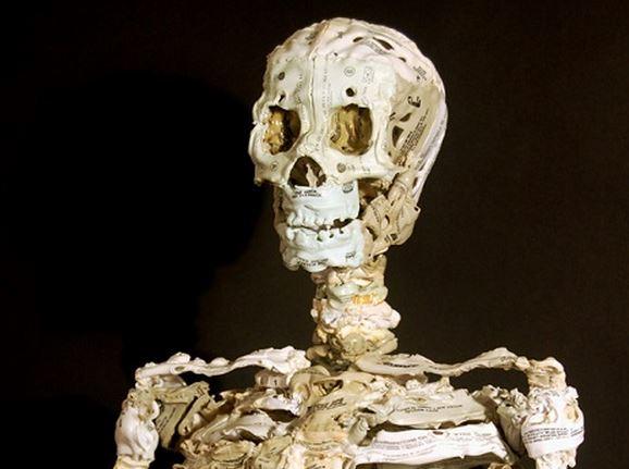 Dead media: Skeleton sculptures made from cassette tapes