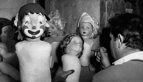 Various, not terrifying at all dolls being painted in a doll factory in Italy, 1950