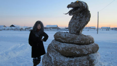 Giant cobra made from frozen shit