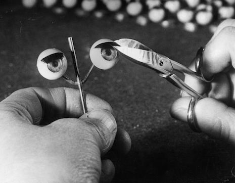 Trimming doll eyelashes, 1949