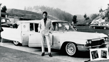 Elvis Presley and his Cadillac limousine by George Barris