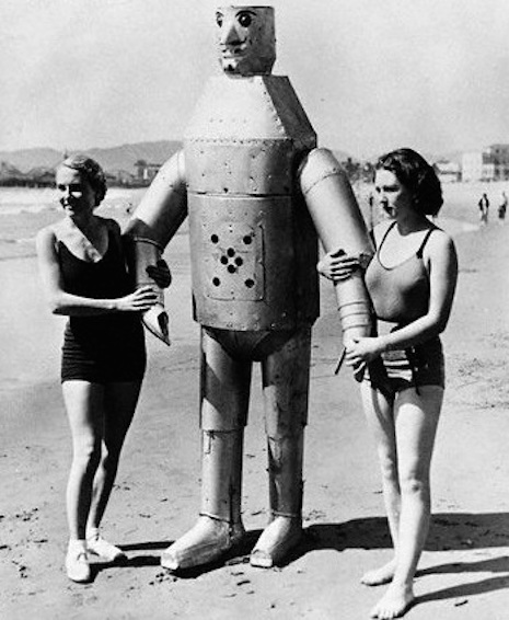 Bathing beauties and a robot hanging out at the beach, 1920s