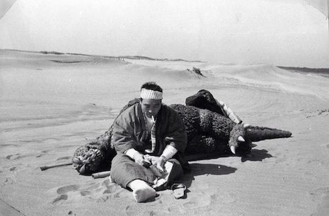 Harou Nakajima taking a smoke break on the beach with Godzilla