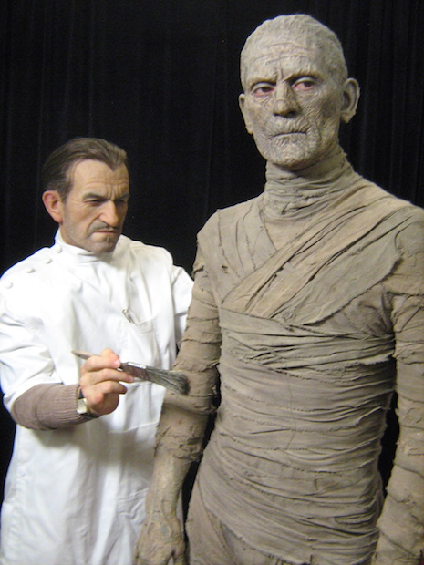 FX artist Jack Pierce putting the finishing touches on Boris Karloff sculpture
