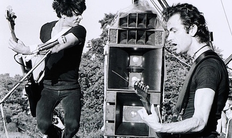 Jean-Jacques Burnel and Hugh Cornwell<br /> Jean-Jacques Burnel and Hugh Cornwell on the stage at Battersea Park in London, September 16th, 1978
