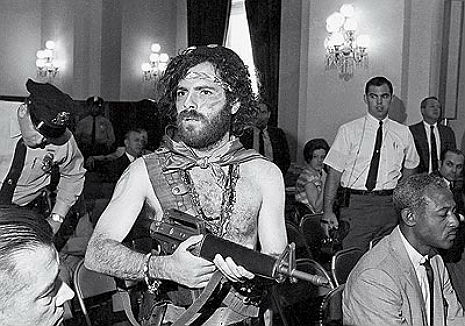 Pre-sellout, proto-punk Jerry Rubin accuses Phil Donahue of slingin' dope in balls-out anti-war rant
