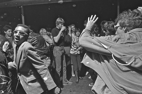 A scenester named Kevin Johnson (in the white glasses) dancing in the crowd at The Island in Houston, Texas 1982