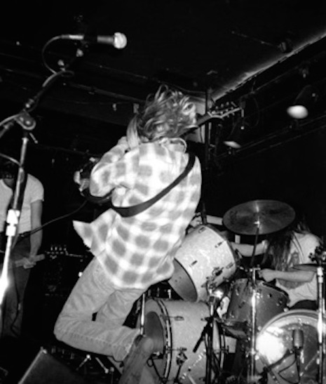 Kurt Cobain jumping into the crowd at Man Ray in Cambridge, Massachusetts, April 18, 1990