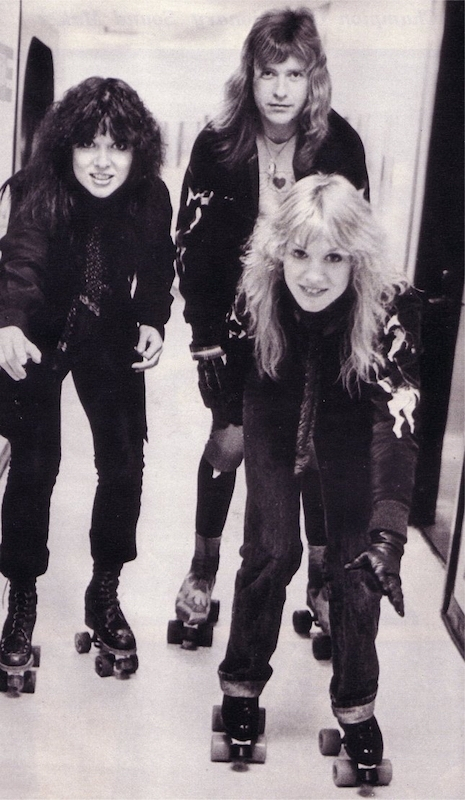 Ann Wilson, Nancy Wilson and Howard Leese backstage at the