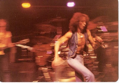 Bon Scott racing across the tiny stage at CBGB's, August 27th, 1977