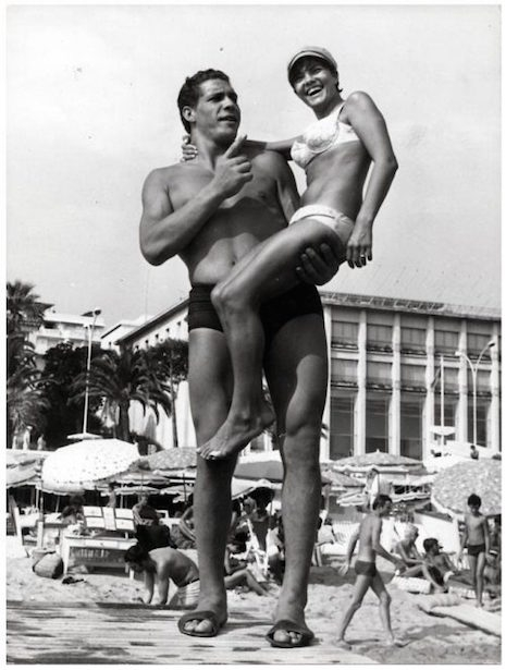 Andre the Giant at the beach picking up chicks