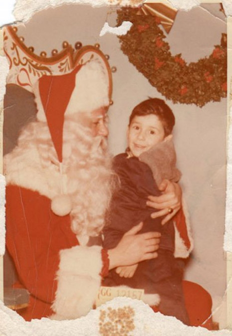 A young Johnny Thunders sitting on Santa's lap