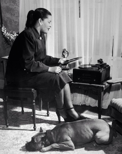 Bille Holiday, her pitbull Mister and her turntable