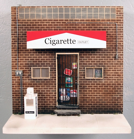 Miniature replica of Cigarette Outlet