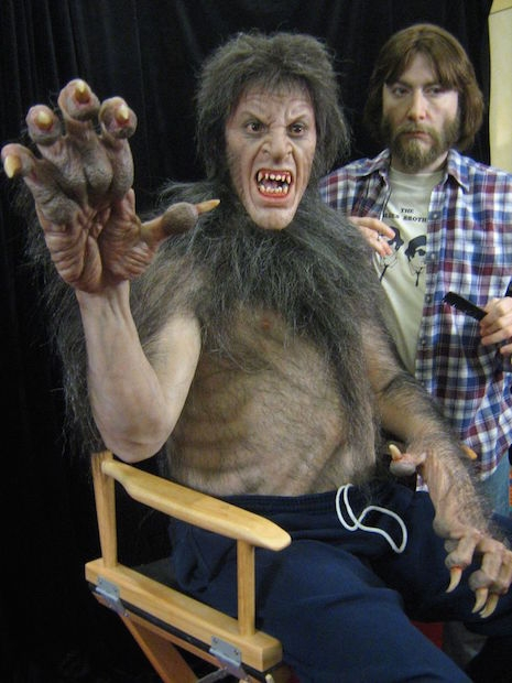 Life-sized sculpture of FX artist Rick Baker bringing helping actor David Naughton become a werewolf