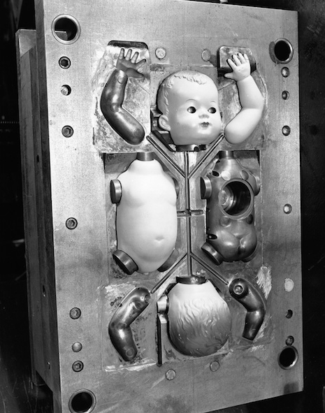 Doll parts in a mold in a factory in England, 1951
