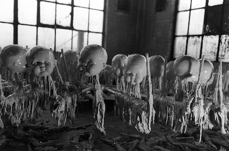 Drying doll heads, 1947