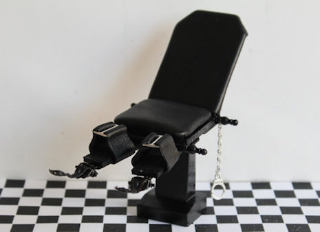 Miniature dollhouse bondage chair with handcuffs