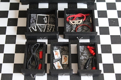 The contents of the drawers in the BDSM miniature cabinet