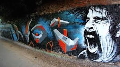 Frank Zappa street art mural under a bridge in London by James Mayle and Leigh Drummond