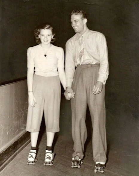 Judy Garland and a 22-year-old Robert Stack on a roller skating date, 1941