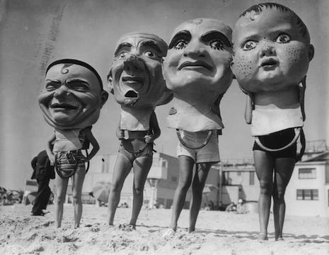Giant papier-mâché masks at the Venice Beach Mardi Gras Festival, 1935