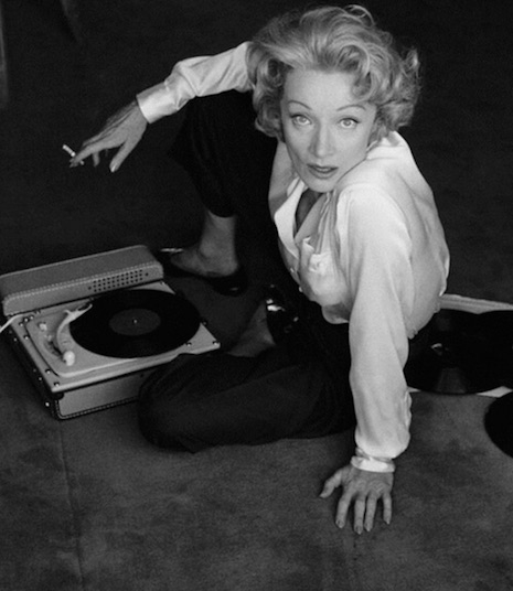 Marlene Dietrich and her turntable, 1956