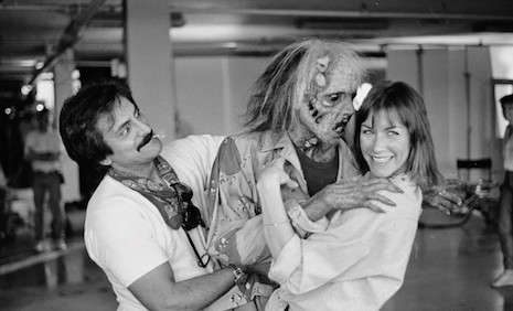 FX master Tom Savini playing around with actress Caroline Williams and one of his gory