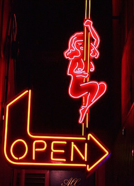 Neon sign with a stripper on a pole