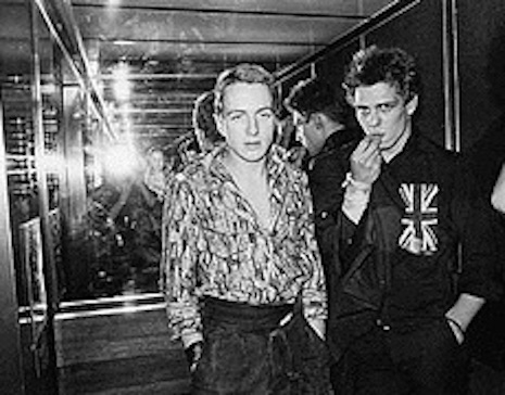 Joe Strummer and Paul Simonon of The Clash on an elevator