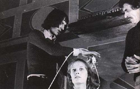 Dario Argento securing a noose around actress Eva Axén in preparation of one of cinema's greatest death scenes