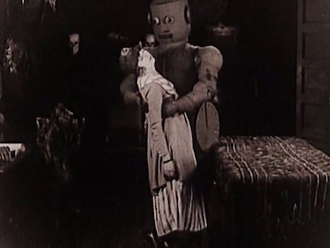 A robot and his female victim in the film, The Master Mystery, 1920