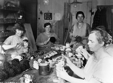 Doll factory workers styling doll hair, Germany 1931